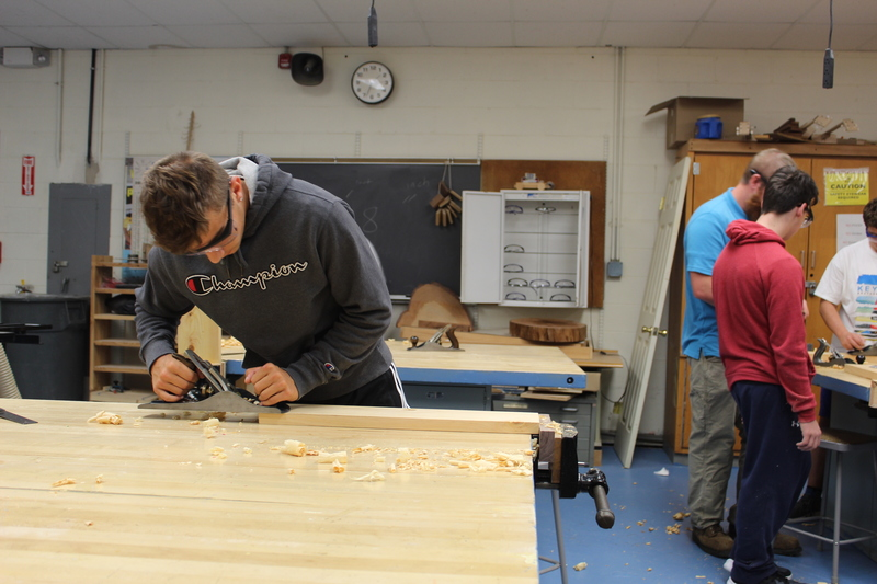 student working in woodworking shop