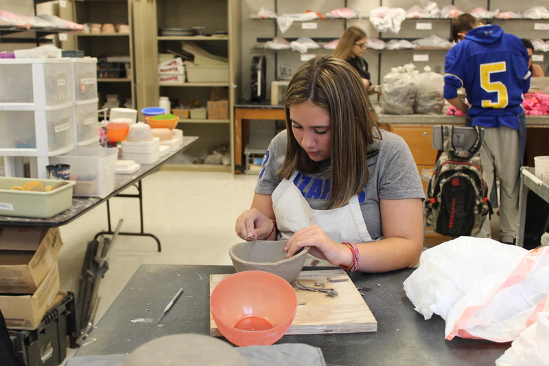 student working in clay class